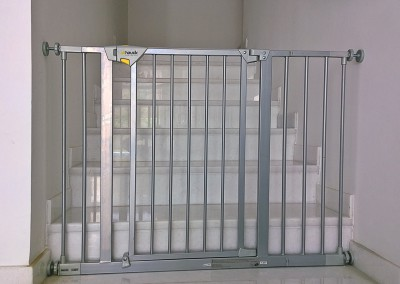 Hauck safety gate at foot of stairs - Meadows