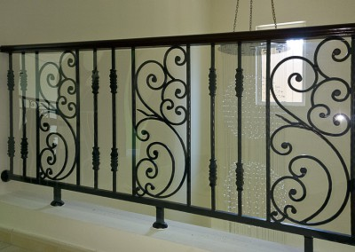 Polycarbonate safety shield on gallery railings in Jumeirah Islands.